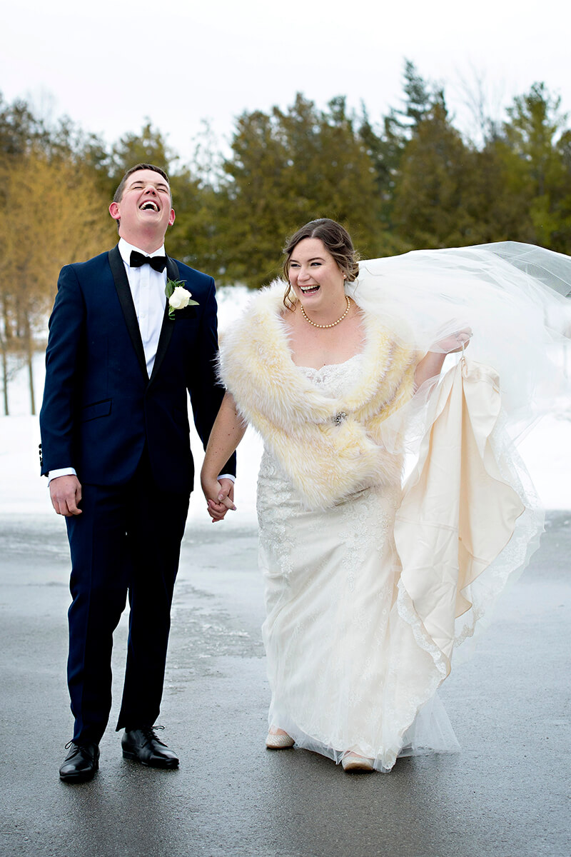 Winter wedding couple laughing grand bend wedding